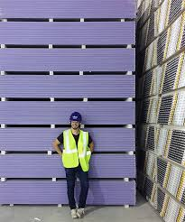 purple xp here is me in front of an enormous tower of it at the plant yeah i got to go to the plant jealous thought so it was awesome