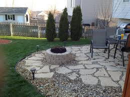 cool stacked stone firepit with pea gravel patio and natural stone paver also patio furniture