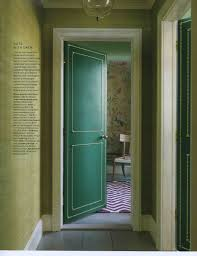 enchanting door paint color with grasscloth wallpaper and comfy chair with area rug