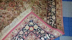 color fading on artificial silk rug
