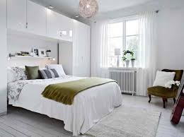 White Bed Plus Storage Above And Wardrobe Beside Combined With Glass  Windows And White Curtains On