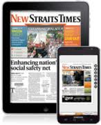 Image result for reading New Straits Times