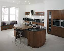 Classy Black Oval Granite Tops Kitchen Island With Seating Of Round  Backless Stools On White Tiles Floors And Brown Kitchen Cabinet Set In  Large White Open ...