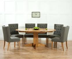solid oak round extending dining table with fabric chairs 8 solid oak round extending dining table with fabric chairs 8