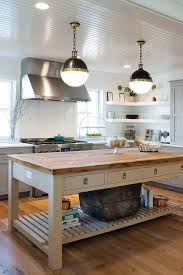 gray freestanding kitchen island with shelf and wood countertop