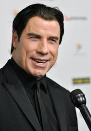 Actor John Travolta speaks with television reporters as he arrives for the 2014 G'Day USA Los Angeles Black Tie Gala in Los Angeles, Jan. 11, 2014. - John-Travolta-wants-to-play-a-James-Bond-villain