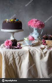 chocolate cakes easter flowers vase holiday table decoration easter cakes stock photo