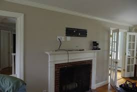 tv mounted above fireplace hide wires