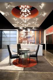 kitchen and dining area with bubble chandelier lighting and surrounding task lighting