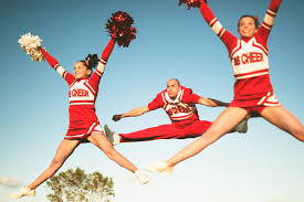 cheerleaders jumping with pom poms