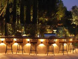 outdoor lighting idea. Cool Outdoor Bar And Metal Swivel Stools Design Plus Captivating Landscape Lighting Idea Feat Tall Iron
