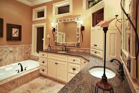 this elegant bathroom features a painted corner vanity with two sinks