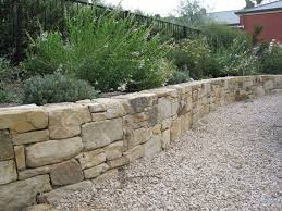 Small Picture The 25 best Stone retaining wall ideas on Pinterest Retaining