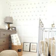 eight point silver star wall decals in an equally spaced pattern placed on off white polka polka dot wall borders adorable decal design for nursery white