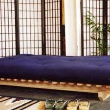 Japanese Bedroom Decor With Futon Bed And Divider And Wall Art