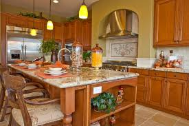 custom kitchen island ideas. Warm Wood Tones Unify This Kitchen Featuring Large Island With Ample Seating Area, Built- Custom Ideas