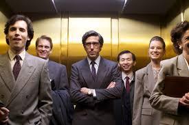 people standing in elevator. grey london is going up people standing in elevator