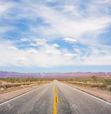An Empty Desert Road In Mojave National Monument Stock Photo