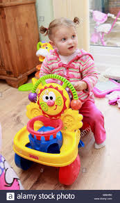 2 year old girl playing with toys Stock Photo: 24107082 - Alamy