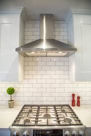 Zodiac London Sky quartz countertops Brite white subway tile