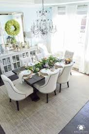 elegant lauren s surprise blue dining room with world market linen lydia chairs and restoration hardware buffet