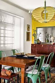 part contemporary and part art deco the chandelier above the teak dining table was designed