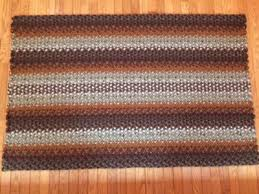 3 4 x 5 1 flip rectangle wool braided rug hand laced in earthtone colors made with coat weight wool