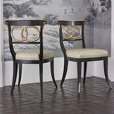 ambella home collection dolphin chair black gold find this pin and more on dining chair inspiration
