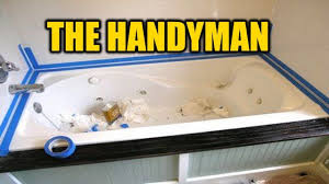 how to caulk a bathtub the right way the handyman