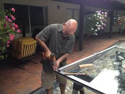 a 1 on track owner louis repairing 50 year old sliding glass door rollers