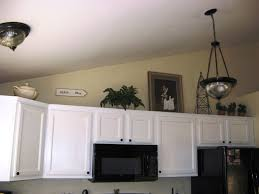 image of decorate tops of kitchen cabinets ideas