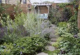 a wild leafy look was the starting point for this 21 x48 row house garden belonging to a single man he wanted a country type feel says garden
