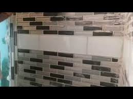 how clean grout off of glass tile