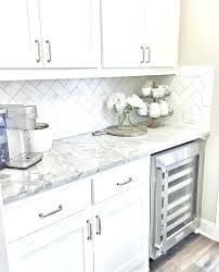 grey and white backsplash wine fridge white cabinets grey counters white tile backsplash grey grout