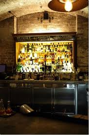 back bar lighting. For The Little BarNot That Yellowish Light.. I Like Stair Effect Of Drinks On Back Bar. Brick Wall Must Be Hidden Bar Lighting R