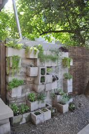 Creative way decor garden home cinder block Bench image Credit Andrea Sparacio Apartment Therapy Budget Backyard 10 Ways To Use Cheap Concrete Cinder Blocks
