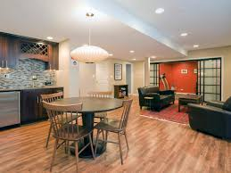 ... Cool Basement Remodeling Ideas Basement Remodeling Ideas Photos White  Basement Wall With Black Sofa ...