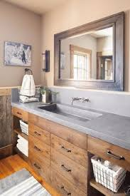 cabinets for bathrooms. in the owners\u0027 bathroom, reclaimed oak used else- where house is stained for a darker, more refined look. countertop concrete, cabinets bathrooms t