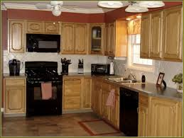 Kitchen With Maple Cabinets And Black Appliances Kitchen