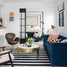 deep blue velvet sofa with black and white stripe rug view full size chic contemporary living room