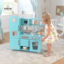 modern playroom with soft blue play kitchen