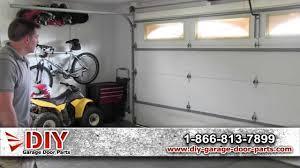 how to level a garage doorLearn How to Level a Garage Door  YouTube