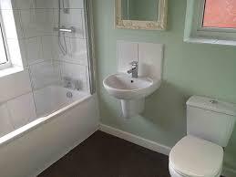 half tiled bathroom with vinyl floor with bathroom installation in leeds