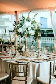 round table decor tall centerpieces for the tables at this tented water works wedding decorations baby