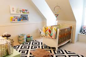 baby room ideas unisex. Appealing Unisex Baby Room Ideas With White Lacquer Finish Walnut F Crib On Cool Black Patterned Rugs 4752x3168
