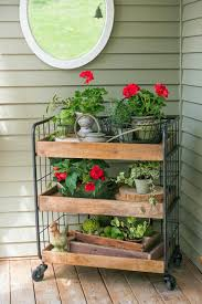 Amazing rustic garden decor ideas Vintage Grocers Trolley Gardening Display 47 Best Rustic Farmhouse Porch Decor Ideas And Designs For 2019