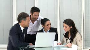 office meeting pictures. happy business team working in modern office. smiling office workers together at new finical meeting pictures