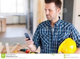 construction worker smart phone stock photo image  construction worker smart phone