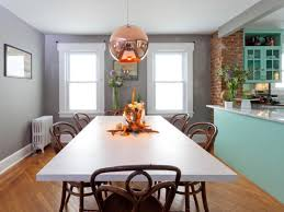 casual transitional dining room with copper light pendant