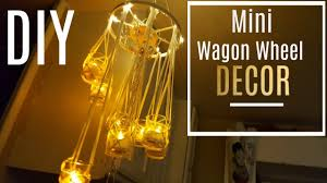 diy mini wagon wheel chandelier made with dowels easy to make